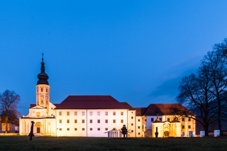 homely: The Cistercian monastery Kostanjevica na Krki, homely appointed as Castle Kostanjevica, illuminated at dusk. Slovenia, Europe.