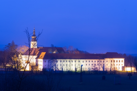 appointed: The Cistercian monastery Kostanjevica na Krki, homely appointed as Castle Kostanjevica, illuminated at dusk. Slovenia, Europe.