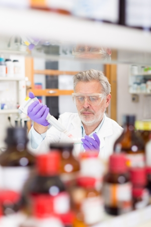 involve: Life scientist researching in laboratory. Life sciences comprise fields of science that involve the scientific study of living organisms: microorganism, plant, animal and human cells, genes, DNA... Stock Photo