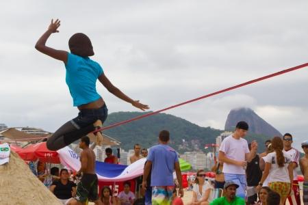 contestant: RIO DE JANEIRO - NOVEMBER 03 2012: Slackline contestant on the sands of Copacabana in Rio Elephant Cup tournament, held on November  03, 2012 on Copacabana, Rio de Janeiro, Brazil.