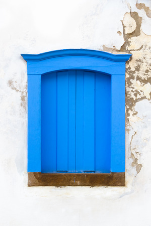 colonial: Decorative, colonial, blue, vintage, window on a white wall in Paraty (or Parati), Brazil.