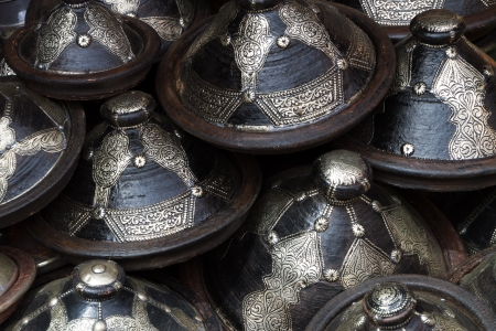 africa antique: Traditional arabic handcrafted, decorated pots shot at the market in Marrakesh, Morocco, Africa. Stock Photo