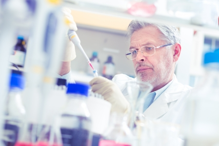 Life scientist researching in laboratory. Life sciences comprise fields of science that involve the scientific study of living organisms: microorganism, plant, animal and human cells, genes, DNA... Stock Photo