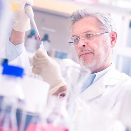 chemical laboratory: Life scientist researching in laboratory. Life sciences comprise fields of science that involve the scientific study of living organisms: microorganism, plant, animal and human cells, genes, DNA... Stock Photo