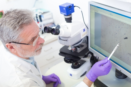 forensics: Senior head scientist  microscoping in the life science research laboratory ( diagnostics, biochemistry, pharmacy, genetics, forensics, microbiology, pharmacogenetics ...)