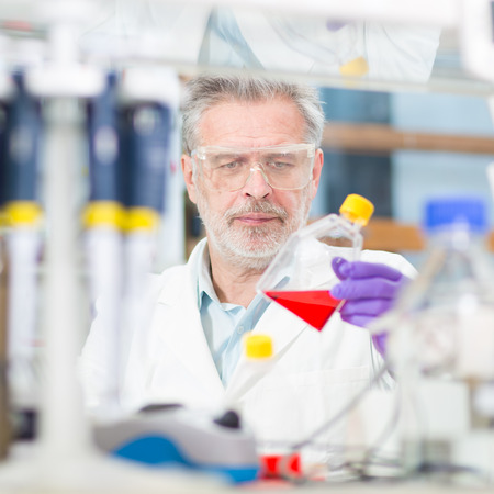 comprise: Life scientist researching in laboratory. Life sciences comprise fields of science that involve the scientific study of living organisms: microorganism, plant, animal and human cells, genes, DNA... Stock Photo