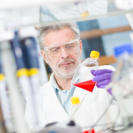 pharmacy technician: Life scientist researching in laboratory. Life sciences comprise fields of science that involve the scientific study of living organisms: microorganism, plant, animal and human cells, genes, DNA... Stock Photo