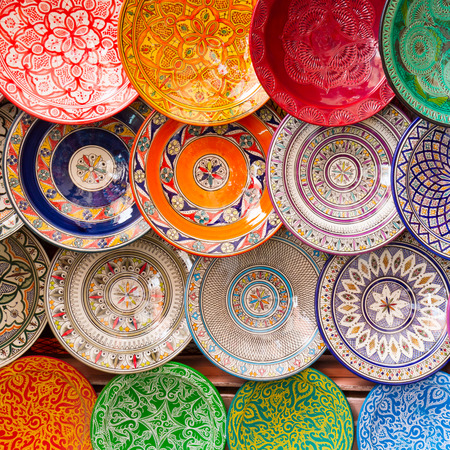 souk: Traditional arabic handcrafted, colorful decorated plates shot at the market in Marrakesh, Morocco, Africa. Stock Photo