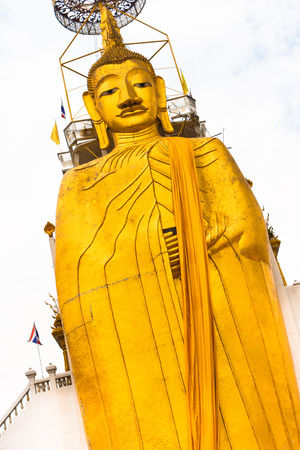 Golden Buddha statue at buddhist temple in Bangkok. photo