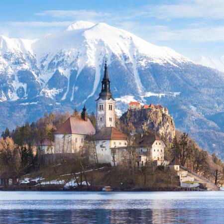 slovenia: Panoramic view of Julian Alps, Lake Bled with St. Marys Church of the Assumption on the small island; Bled, Slovenia, Europe.