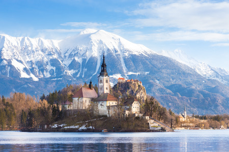 bled: Panoramic view of Julian Alps, Lake Bled with St. Marys Church of the Assumption on the small island; Bled, Slovenia, Europe.