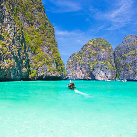 phi phi island: Traditional wooden boat in a picture perfect tropical Maya bay on Koh Phi Phi Le Island, Thailand, Asia.