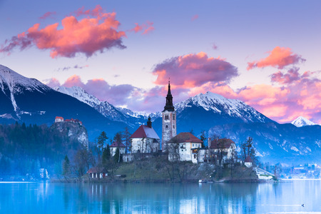 bled: Sunset view of Julian Alps, Lake Bled with St. Marys Church of the Assumption on the small island; Bled, Slovenia, Europe.