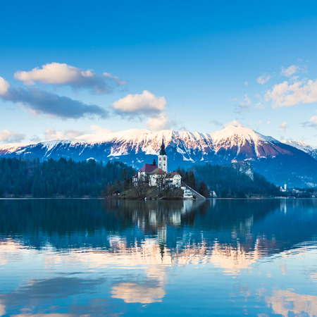 bled: View of Julian Alps, Lake Bled with St. Marys Church of the Assumption on the small island; Bled, Slovenia, Europe.