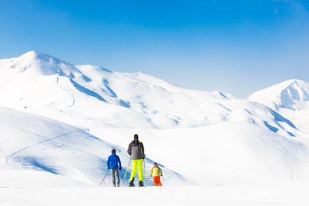Family on winter ski vacations in ski slopes in Alps, Vogel, Slovenia, Europe. photo