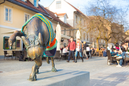 Artistic detail on a dog sculpture in medieval city center of Ljubljana, Slovenia, Europe.  photo