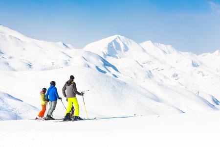 Family on winter ski vacations in ski slopes in Alps, Vogel, Slovenia, Europe.