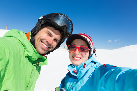 Selfie of couple skiers on winter vacations in the Alp mountains, Triglav natural park, Vogel, Slovenia. photo