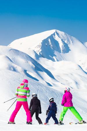 slovenia: Family on winter ski vacations in ski slopes in Alps, Vogel, Slovenia, Europe.