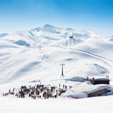 refuge: Skiers on ski slopes in  Alp mountains, Triglav natural park, Vogel, Bohinj, Slovenia.