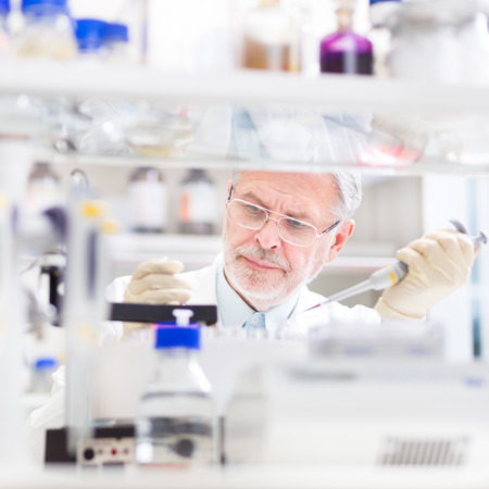 Life scientist researching in laboratory. Life sciences comprise fields of science that involve the scientific study of living organisms: microorganism, plant, animal and human cells, genes, DNA... photo
