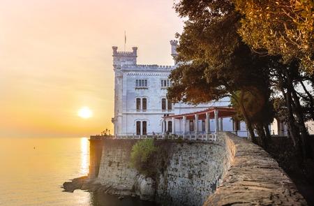 adriatic sea: Miramare Castle, Castello di Miramare, in sunset. it is a 19th century castle on the Gulf of Trieste near Trieste, Italy. It was built for Austrian Archduke Ferdinand Maximilian.