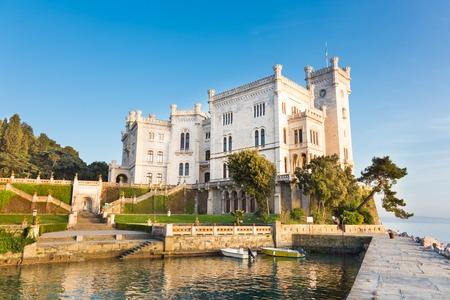 Miramare Castle, Castello di Miramare, in sunset. it is a 19th century castle on the Gulf of Trieste near Trieste, Italy. It was built for Austrian Archduke Ferdinand Maximilian.