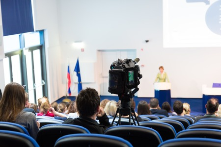 Business Conference and Presentation. Audience at the conference hall. Television broadcasted press conference. photo