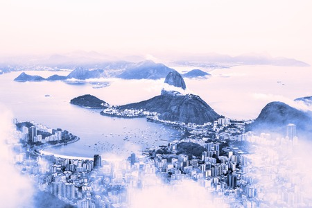 mistic: Rio de Janeiro, Brazil. Suggar Loaf and  Botafogo beach viewed from Corcovado at sunrise.
