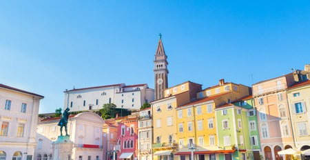 old town townhall: The Tartini Square (Slovene: Tartinijev trg, Italian: Piazza Tartini) is the largest and main square in the town of Piran, Slovenia. It was named after violinist and composer Giuseppe Tartini. Stock Photo