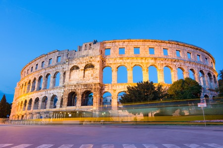 best ad: The Roman Amphitheater of Pula, Croatia shot at dusk. It was constructed in 27 - 68 AD and is among the six largest surviving Roman arenas in the World and best preserved ancient monument in Croatia.
