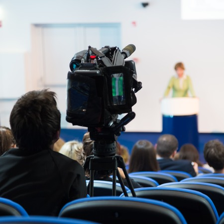 Business Conference and Presentation. Audience at the conference hall. Television broadcasted press conference. Stock Photo