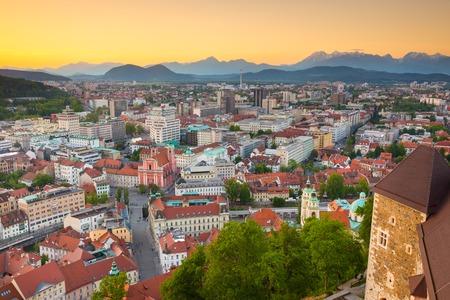 ljubljana: Panorama of the Slovenian capital Ljubljana at sunset. Alps mountains Stock Photo