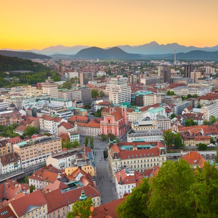Panorama of the Slovenian capital Ljubljana at sunset. Alps mountains photo