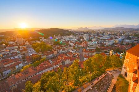 slovenian: Panorama of the Slovenian capital Ljubljana at sunset. Alps mountains Stock Photo
