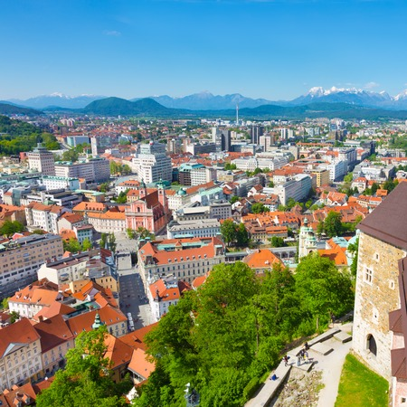Panorama of the Slovenian capital Ljubljana. Alps mountains in the background. photo