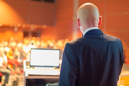 Speaker at Business Conference and Presentation Audience at the conference hall. Stock Photo