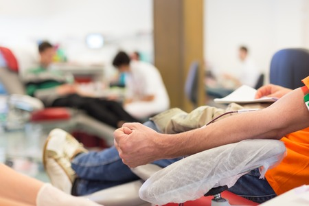 donations: Role of nurses in blood services and donor sessions.  Nurse and blood donor at donation. Stock Photo