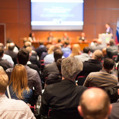 listeners: Business Conference and Presentation. Audience at the conference hall. Stock Photo