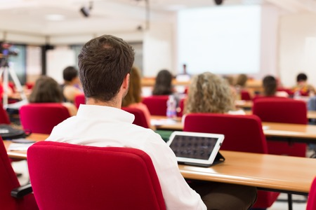 lecture room: Business workshop and presentation. Audience at the conference room. Stock Photo