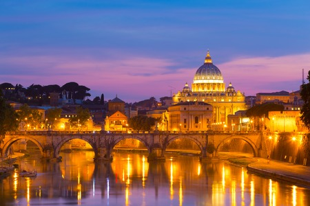 Night view of old roman Bridge of Hadrian and St  Peter s cathedral in Vatican City, Rome, Italy  photo