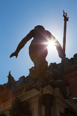 eponymous: Silhouette of Fountain of Neptune, monumental civic fountain located in the eponymous square Piazza Nettuno next to Piazza Maggiore in Bologna, Italy