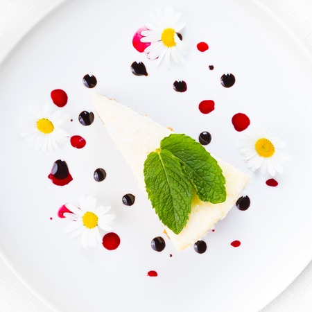 Dessert - Cheesecake with Green Mint decorated with dasiy flowers and decorated with fruit syrup drops