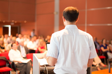 lecturing: Academic professor lecturing at Conference  Audience at the lecture hall  Stock Photo