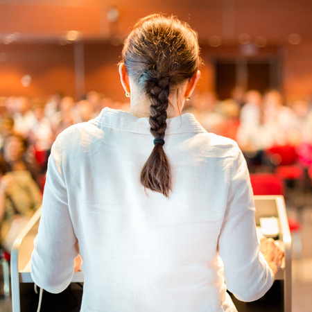 Female academic professor lecturing at Conference  Audience at the lecture hall  photo