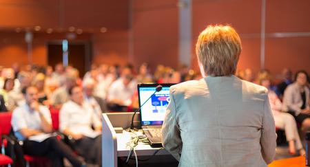 lecturing hall: Senior business woman lecturing at Conference  Audience at the lecture hall  Stock Photo