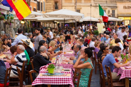 ROME, ITALY - JUNE 13 2014  People having aperitif which in Italy traditionally includes free all you can eat buffet of pizzas and pastas, on JUNE 13 2014 on Piazza Campo Dè Fiori in Rome in Italy