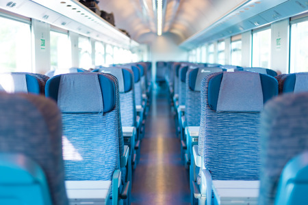 compartments: Modern european economy class fast train interior  Inside of high speed train compartment
