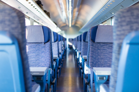 Modern european economy class fast train interior  Inside of high speed train compartment  photo