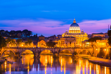 Night view of old roman Bridge of Hadrian and St  Peter s cathedral in Vatican City Rome Italy  photo